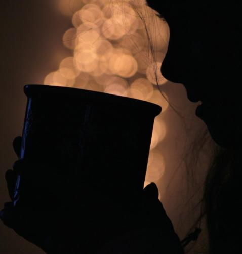 Silhouette cosy winter hot drink, bokeh