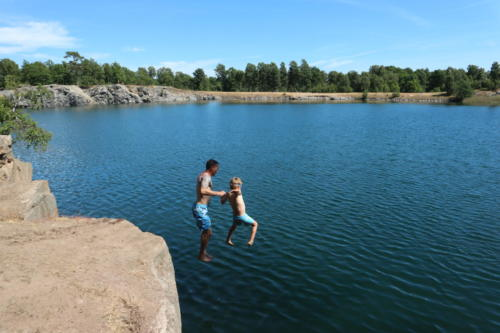 Man and boy jump quarry cliff Torko